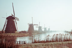 Moinhos de vento holandeses tradicionais no alvorecer Imagens de Stock Royalty Free