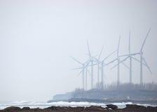Moinhos de vento na névoa do inverno Foto de Stock Royalty Free