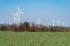 Moinhos de vento no campo Foto de Stock Royalty Free