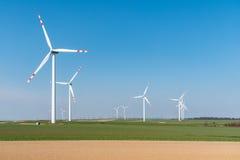 Moinhos de vento no campo Imagem de Stock Royalty Free