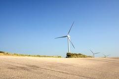 Moinhos de vento no mar Imagem de Stock