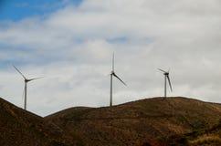 Moinhos de vento no nascer do sol Imagem de Stock