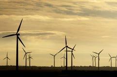 Moinhos de vento no nascer do sol fotos de stock royalty free