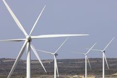 Moinhos de vento no nascer do sol fotografia de stock