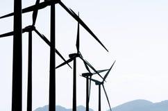 Moinhos de vento no nascer do sol foto de stock