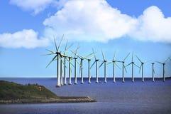 Moinhos de vento no por do sol Imagens de Stock Royalty Free