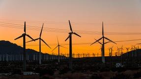 Moinhos de vento no por do sol Fotografia de Stock Royalty Free