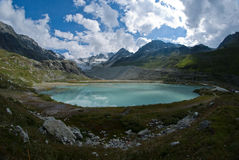 Moiry lake. This alpine lake, situated about 2300 m above sea level, is formed of waters resulting from the melting of the glacier Moiry. It is a perfect place Stock Image