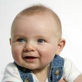 6 mois heureux se reposant et souriant Photos stock
