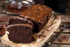 Moist chocolate cake with milk chocolate topping glaze Stock Photos