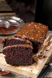 Moist chocolate cake with milk chocolate topping glaze Royalty Free Stock Images