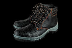Moist modern working boots Stock Photography