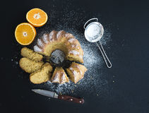 Moist orange bundt yoghurt cake with sugar powder Stock Photos