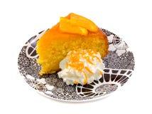 Moist Orange Cake. With cream over white background Royalty Free Stock Photo