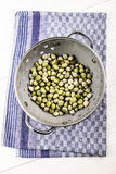 Moist peas in a metal strainer Stock Photography