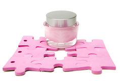 Moistening cream and puzzle Stock Images