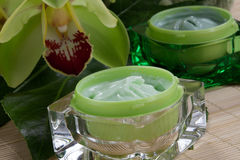 Moisturising Cream wuth Orchids Stock Image