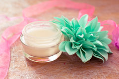 Moisturising creams/lotions for daily spa. Moisturising lotions and flower, spa treatments Royalty Free Stock Photography
