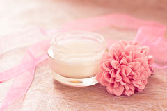 Moisturising creams/lotions for daily spa. Moisturising lotions and flower, spa treatments Stock Photography
