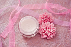 Moisturising creams/lotions for daily spa. Moisturising lotions and flower, spa treatments Stock Image