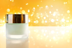 Moisturizer concept jar closed yellow bokeh background Stock Photography