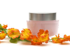 Moisturizer cream and flower Royalty Free Stock Photo