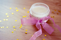 Moisturizer with ribbon and decorative stars Royalty Free Stock Photography