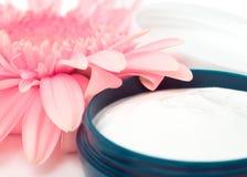 Moisturizing cream. With pink gerbera close up Stock Images
