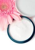 Moisturizing cream. With pink gerbera close up Stock Photos
