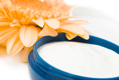 Moisturizing cream. With orange gerbera close up Royalty Free Stock Images