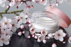 Moisturizing cream with flowers Stock Image