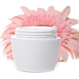 Moisturizing face cream with a pink gerbera Stock Photos