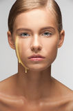 Moisturizing facial cream on female face Royalty Free Stock Photography