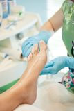 Moisturizing and massage feet pedicure procedure Royalty Free Stock Photo