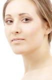 Moisturizing milk drops. Beautiful woman with moisturizing milk drops on face Stock Photo