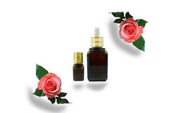 Moisturizing serum for dry skin and roses, on isolate background.  stock photos