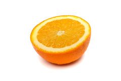 Moitié d'une orange mûre sur un fond d'isolement Photo stock