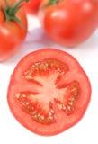 Moitié d'une tomate Images stock