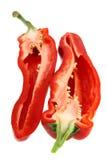 Moitié deux de poivron rouge coupé en tranches Photos libres de droits