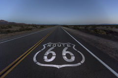 Mojave Desert Dusk on Route 66. Route 66 pavement sign and desert dusk near Amboy California Royalty Free Stock Image