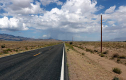 Mojave desert road, rain ahead. Desert road in the Mojave. On the way to the Grand Canyon. A rain storm is building up ahead Stock Images