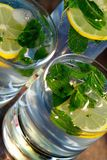 Mojito - alcoholic drink. With mint and lemon Stock Photography