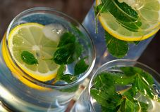 Mojito - alcoholic drink. With mint and lemon Royalty Free Stock Photos