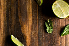 Mojito background. Wooden table, lemon and mint stock photography