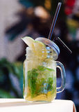 Mojito in a bank. Over vintage background royalty free stock photos