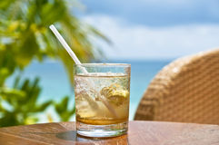 Mojito at a beach bar. Glass with a cold drink at a beach bar Royalty Free Stock Images