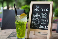Mojito Chalk lettering. Cocktail and recipe on the blackboard. Royalty Free Stock Image