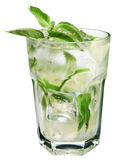 Mojito cocktail. A glass filled with a Mojito cocktail garnished with mint leaves isolated on white studio background stock image