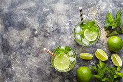 Mojito cocktail alcohol bar drink traditional Cuban fresh tropical beverage top view copy space two highball glass with. Mojito cocktail alcohol bar drink Stock Photography