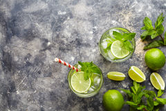 Mojito cocktail alcohol bar drink traditional fresh tropical beverage top view copy space two highball glass. With rum, citrus slice, spearmint, lime juice Stock Photo